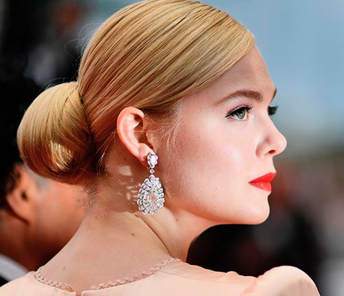 "TOPSHOT - US actress and member of the jury of the Cannes Film Festival Elle Fanning poses as she arrives for the screening of the film ""The Dead Don't Die"" during the 72nd edition of the Cannes Film Festival in Cannes, southern France, on May 14, 2019. (Photo by CHRISTOPHE SIMON / AFP)        (Photo credit should read CHRISTOPHE SIMON/AFP/Getty Images)"